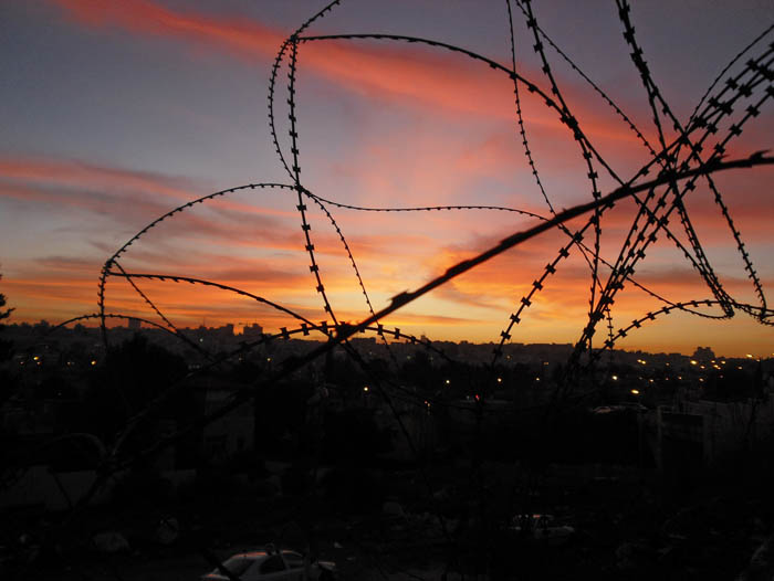 Sunset through barb wire in Jerusalem