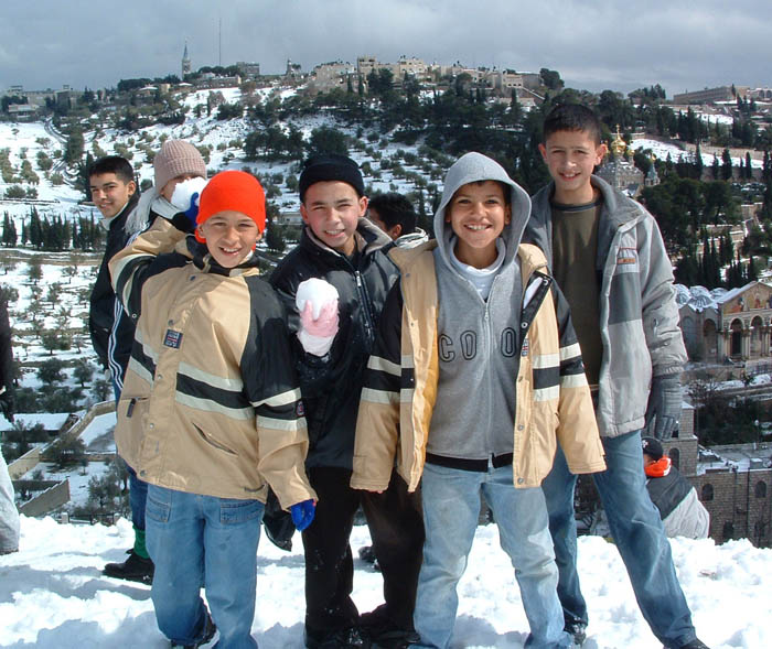 Arab kids playing in the snow in Jerusalem